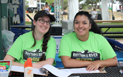 Rhythmn on the River volunteers help with event information