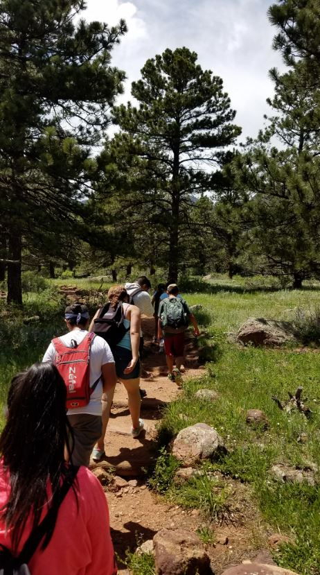 High School Zone hiking through the forest