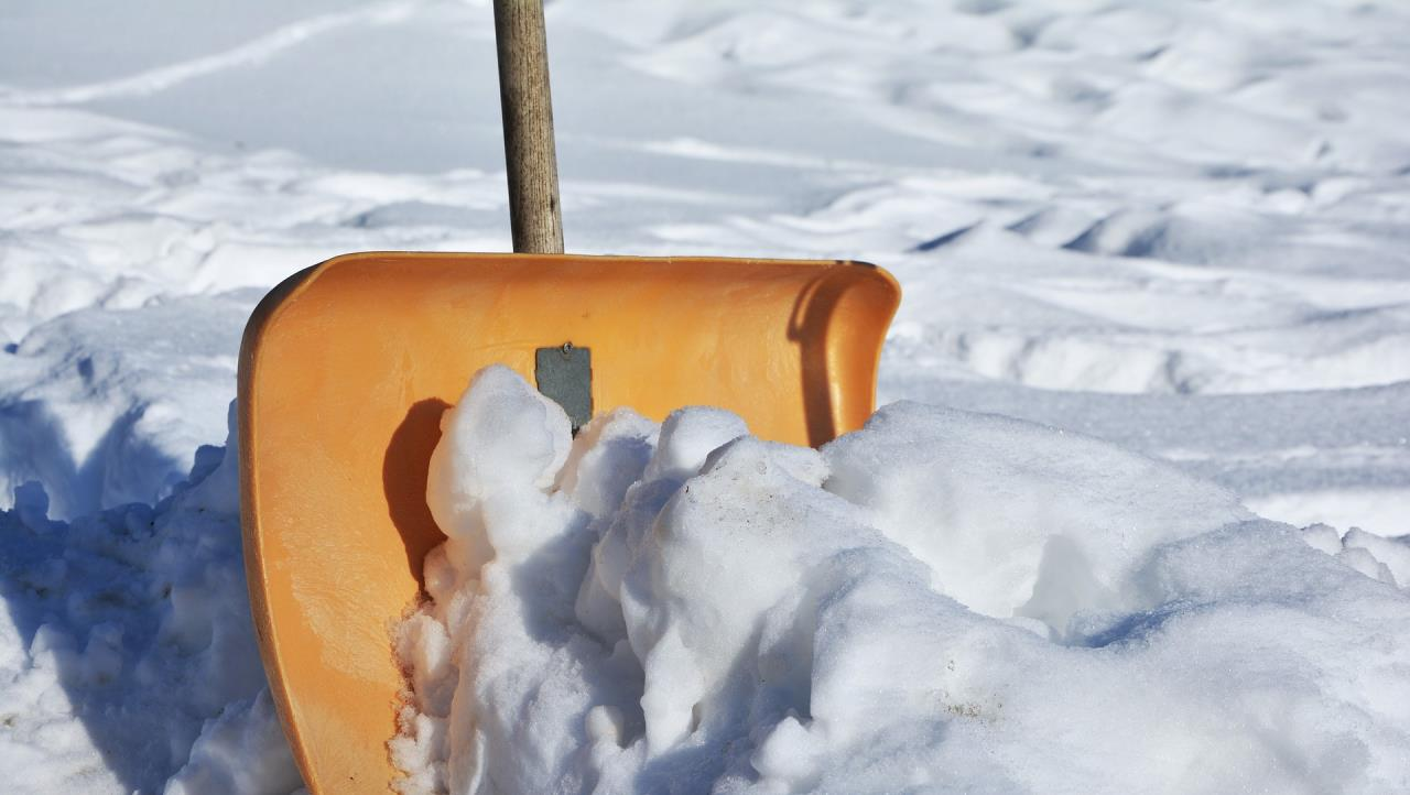 Snow Shovel planted in snow