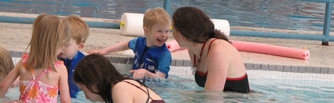 special needs therapeutic swim lessons boy pool
