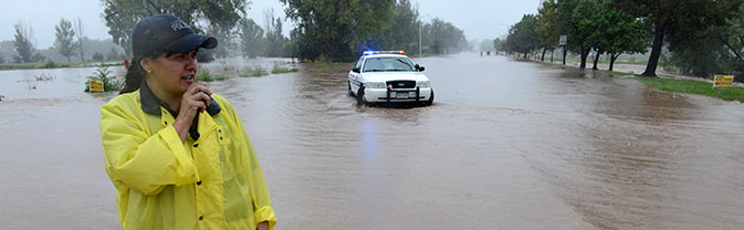 Officer standing at flooded street