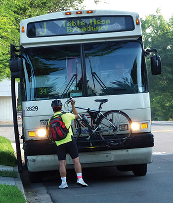 RTD bus passenger attaches bike to front of bus
