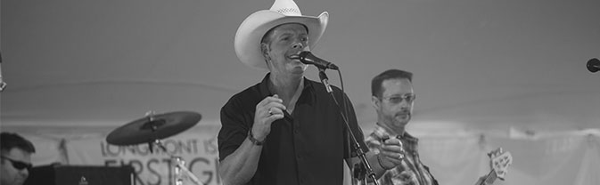 rotr_cowboy singing at Rhythm on the River