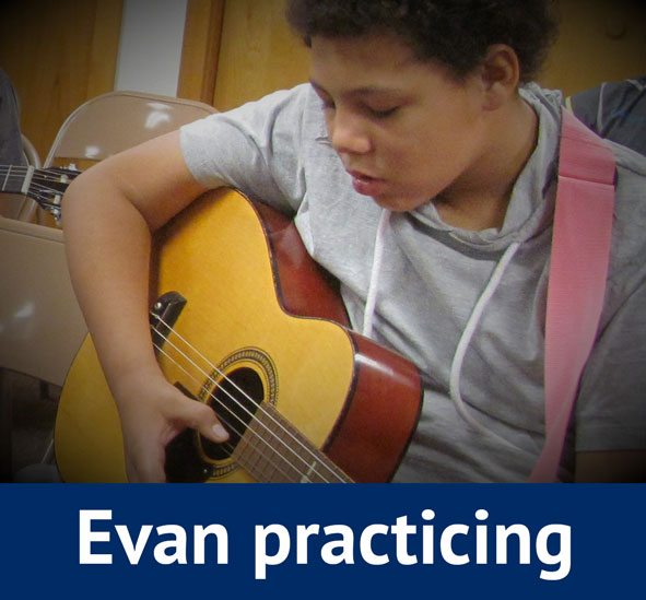 Evan Practicing Guitar