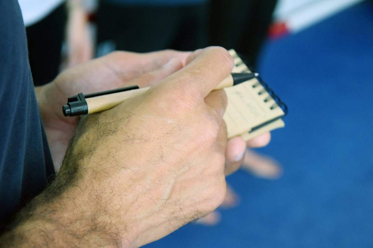 Hands with pen and notebook picture
