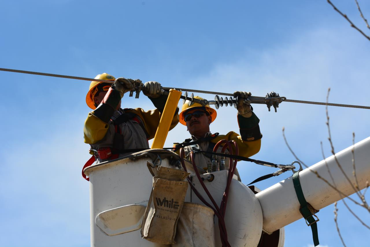 Lineworkers in Bucket Working on Power Line