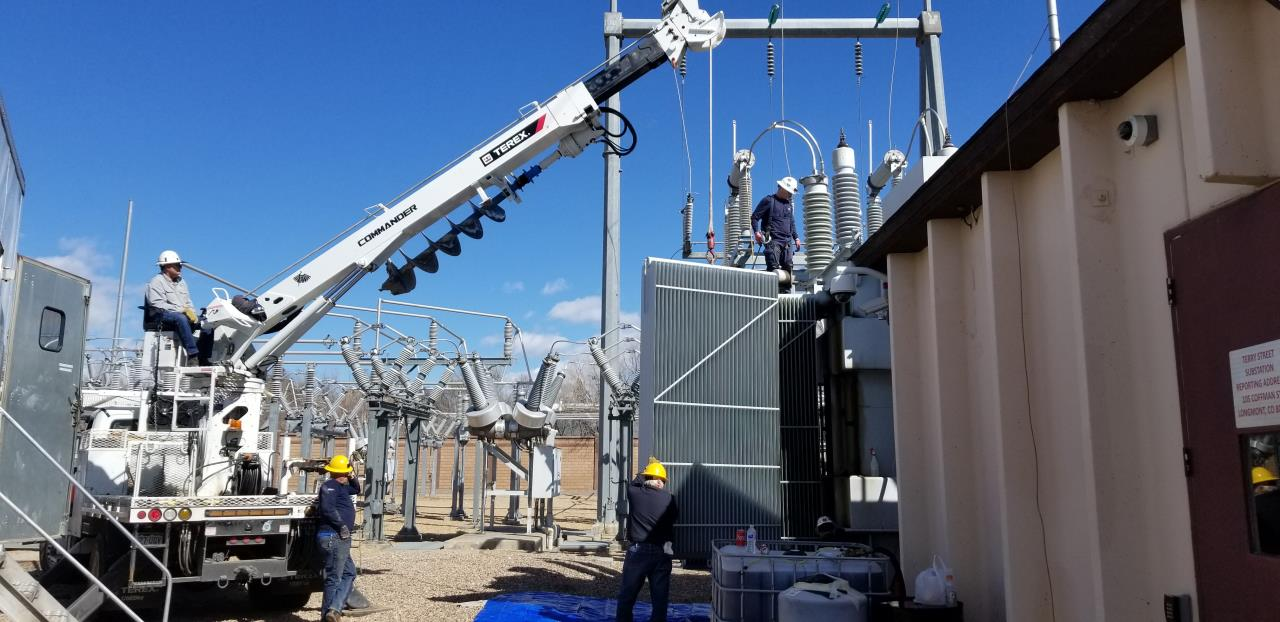 Longmont electric crews working on substation
