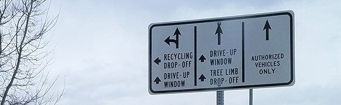 Directional arrows on sign at Waste Diversion Center