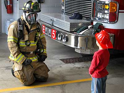 Firefighter and young recruit