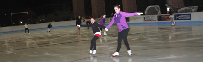 two girls skate at ice pavilion