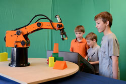 Three children and the robotic arm