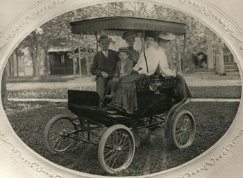 Historical photo of Callahan family with automobile